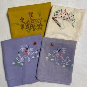 Four Antique Pillow Cases with Embroidery Designs